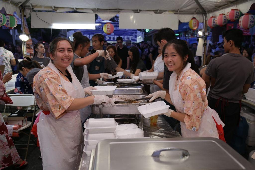 Volunteers at the Orange Intl Food Fair