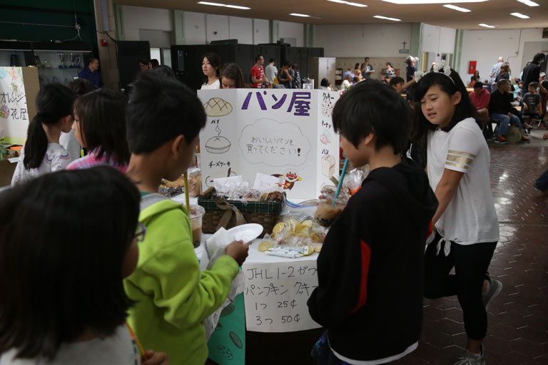 students learning during harvest festival event