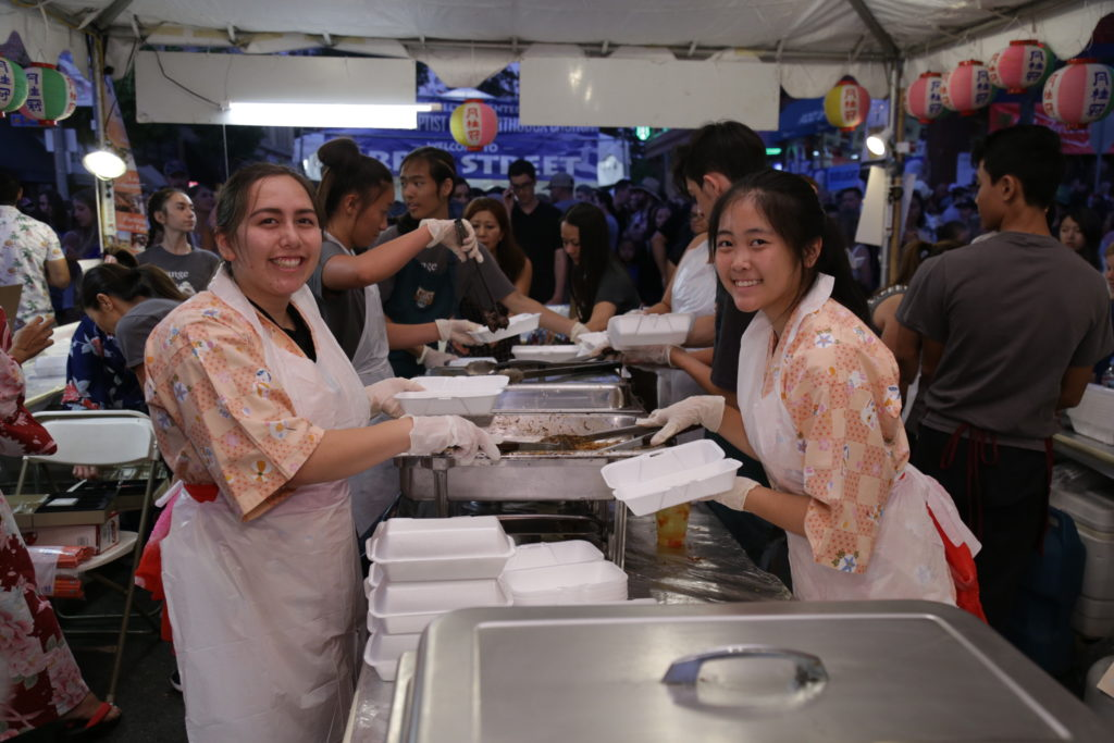 Volunteers at the Orange Intl Food Fair
